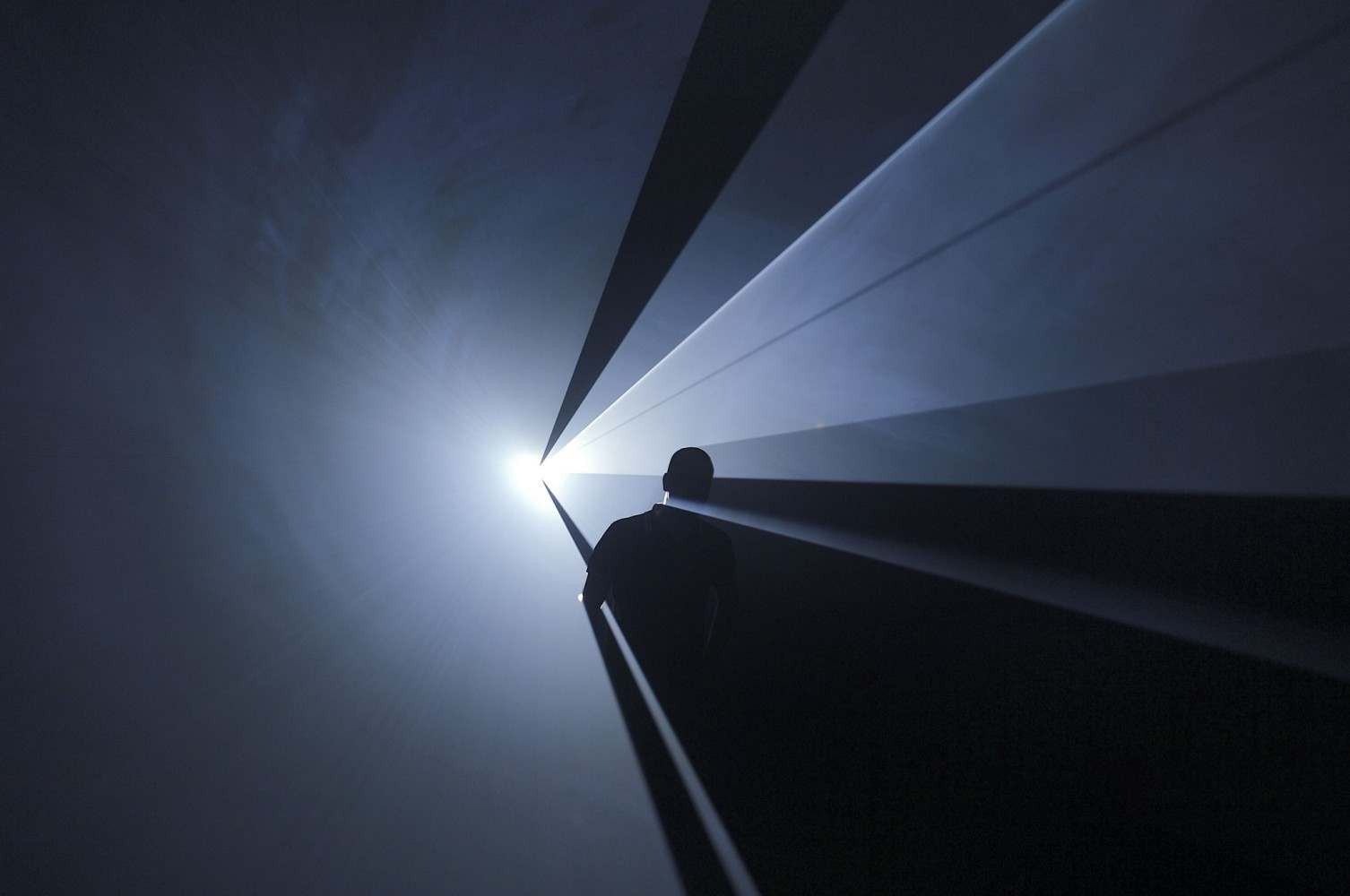 "Anthony McCall. ""You and I Horizontal"" (2005). Installation view at Institut d'Art Contemporain, Villeurbanne, France (2006). Photograph by Blaise Adilon."
